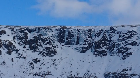 Ice covered mountain crag.